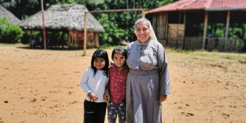 Sister Rosa Elena Pico, a member of the Missionaries of Mary Co-Redemptrix, with children from the indigenous community of Sarayaku, Ecuador, in September 2019. Photo: CNS