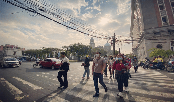 Tourists wear face masks while walking around Manila. Photo: UCAN/Joe Torres