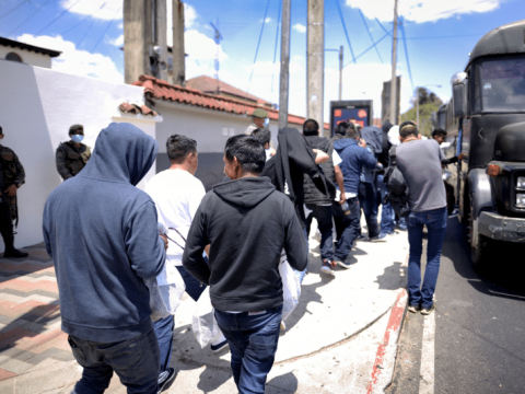 Guatemalans deported from the US board a bus outside La Aurora International Airport in Guatemala City on March 19. Photo: CNS/Reuters