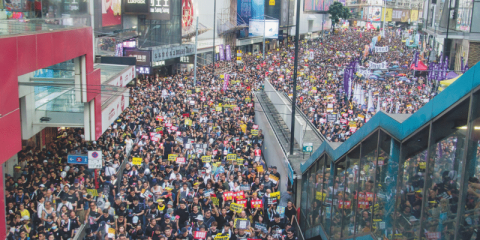 Protestors in black fill all the lanes of Hennessy Road in Causeway Bay, during the massive annual July 1 protest rally in 2019.