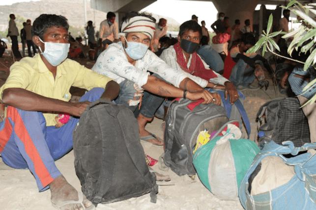 Migrant workers wait to cross the Delhi-Uttar Pradesh state border on May 16. Photo: UCAN/Bijay Kumar Minj