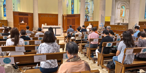 People attending Mass at the Cathedral of Immaculate Conception, Caine Road, on June 1. Signs indicate that they should sit one metre apart from one another.