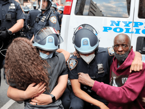 New York City police officers and protestors embrace during a demonstration on June 2, following the death of George Floyd. Photo: CNS/,Reuters
