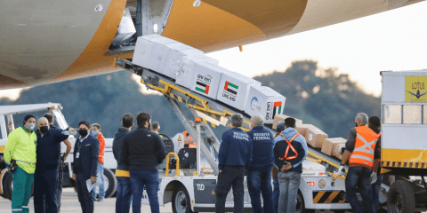 Medical supplies donated by the United Arab Emirates are unloaded from an aircraft in Brasilia, Brazil, on July 6. Photo: CNS/Reuters