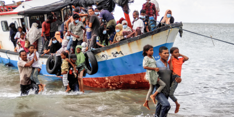 Rohingya refugees evacuated from a boat near the coast of Seunuddon beach in Aceh, Indonesia, on June 25. Photo: CNS/Antara Foto, Rahmad via Reuters