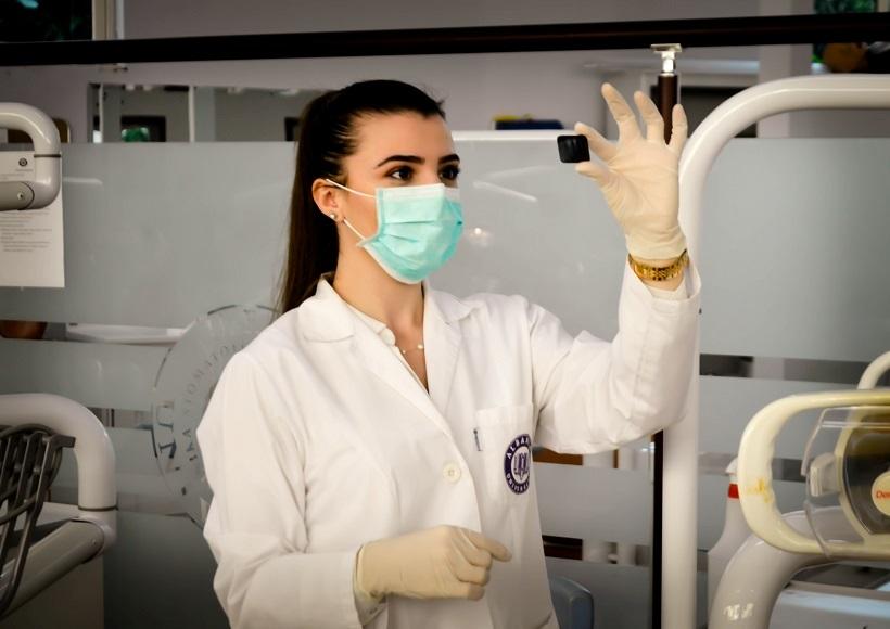Woman inside laboratory; Credit: Photo by Ani Kolleshi on Unsplash