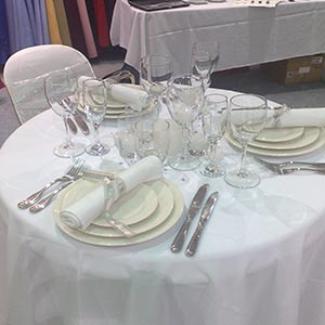 AFC Banquet Crockery with Elegant Cutlery all on crisp white linen