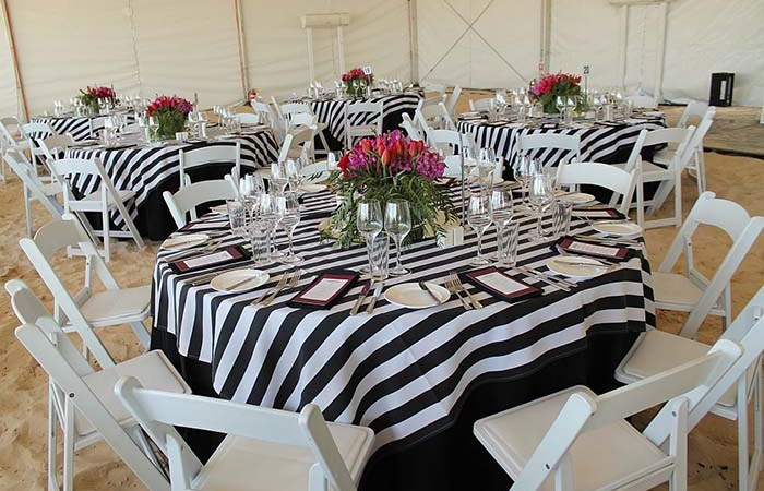 Vogue white folding chairs for corporate beach event