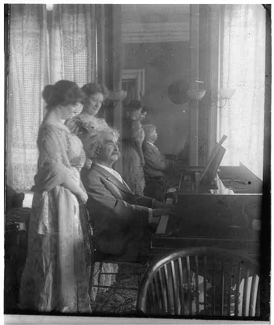 Samuel Clemens playing the piano, with Clara Clemens and her friend Miss Marie Nichols, c1908.