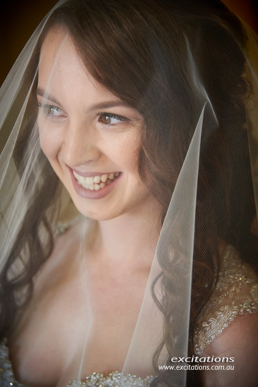 Closeup of very pretty bride under veil, natural light wedding portrait. Wedding photos by Excitations, Mildura.