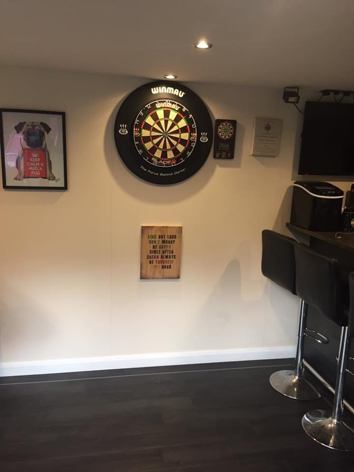 exclusiveexteriors image of bar dart board