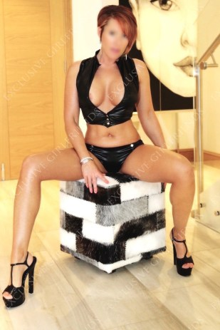 Lucy Wet look on stairs.Legs open by Exclusive Girlfriends, Escorts Woking