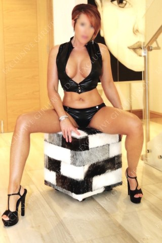 Lucy Wet look on stairs by Exclusive Girlfriends, Escorts Woking