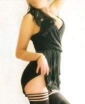 Molly in a black Grecian style dress