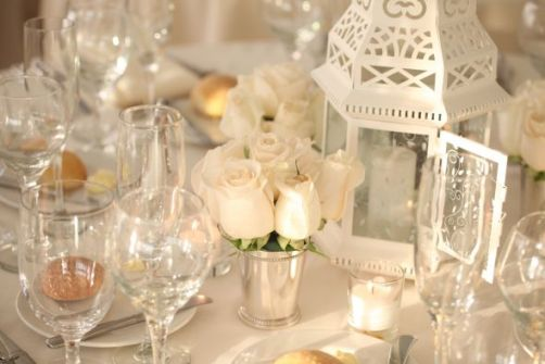Romantic white lanterns table centerpiece - Source: Weddingbee