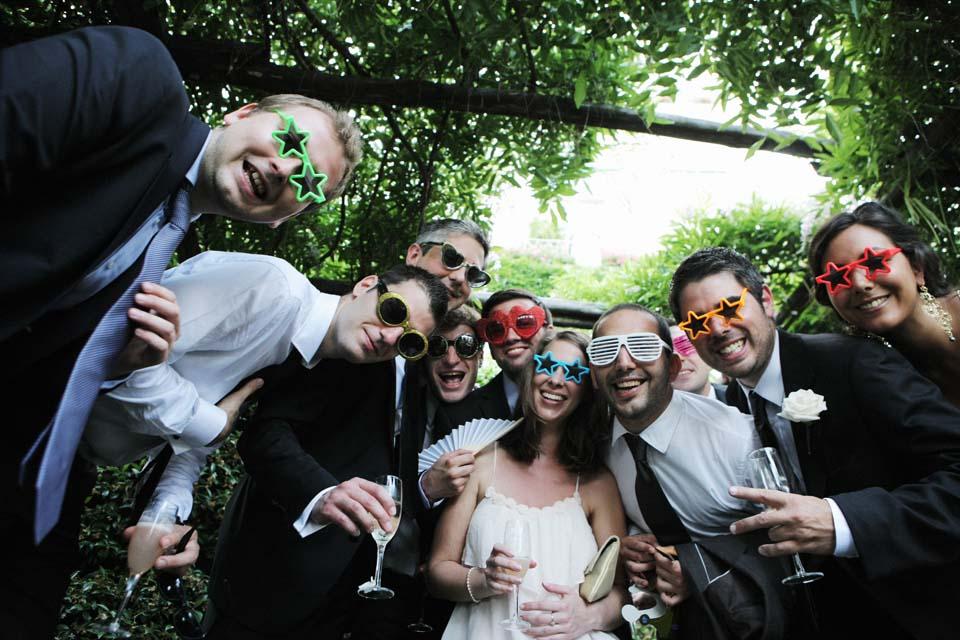 Guests having fun at wedding photo booth