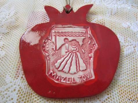 Ceramic pomegranate tile: the pomegranate is a symbol of fruitfulness.
