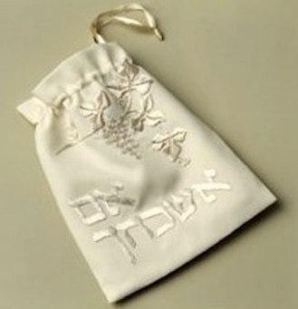 Hand embroidered wedding glass bag.