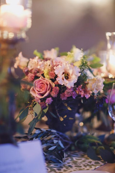 Pale pink and purple flowers for wedding reception
