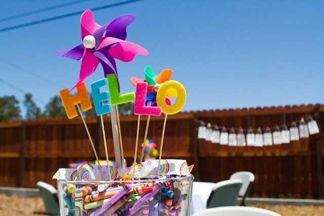Children table centerpiece with crayons and pinwheel