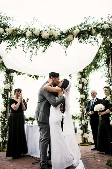 Romantic outdoor wedding with white chuppah