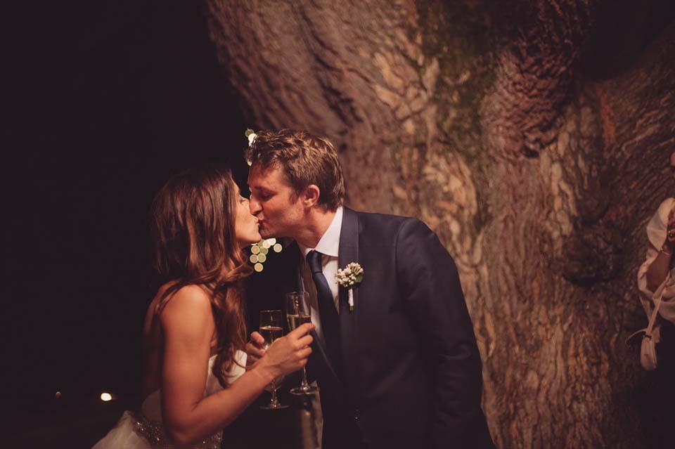 Newlyweds toasting at Tuscany castle wedding