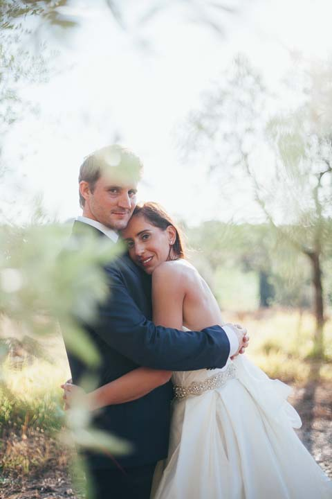 Bride and groom in the olive groves of the Chianti region