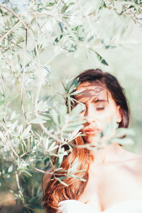 Portrait of the bride among the olive groves of Tuscany