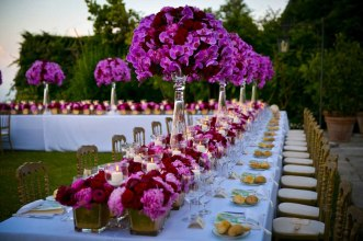 Pink and red orchids for Italian wedding reception