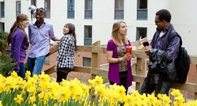 international students  conversing together
