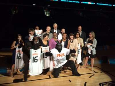 The Phoenix Suns' mascot, the Gorilla, poses with members of the Democratic National Convention's technical advisory committee at US Airways Center on Sept. 10.