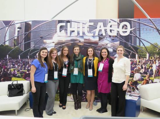 PCMA E-board at Chicago's visitor booth (left to right) Christine Corsi, Hannah Lewandowski, Christine Wilson, Sarah Anderson, Lisa Malinowski, Monica Blaze and Carlie Smith.