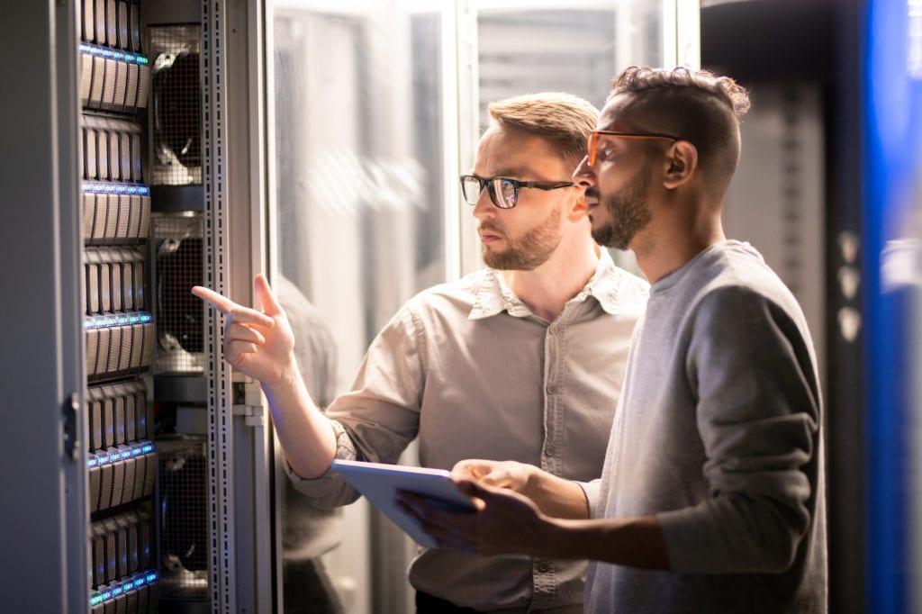IT team finalizing their data center decommissioning checklist.