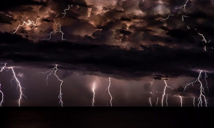 Storm with lightning strikes on a dark horizon.