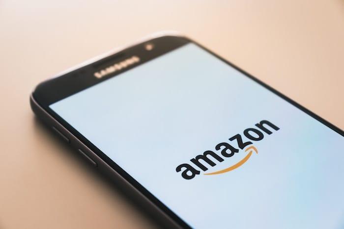 Phone screen showing the Amazon logo.