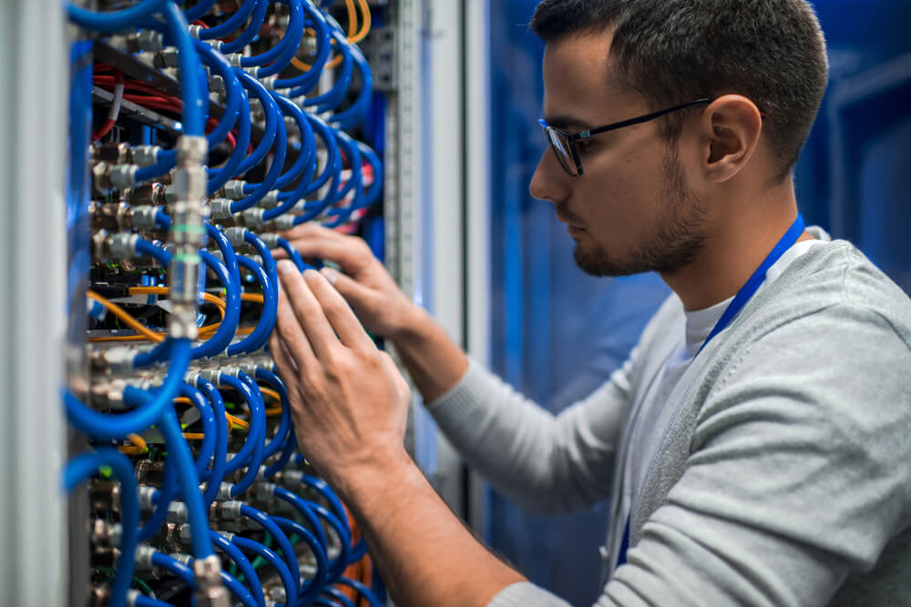 Sys admin inspecting infrastructure