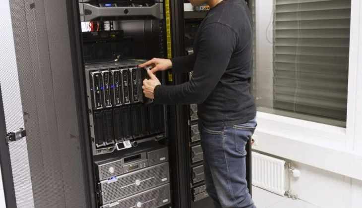 Guy decommissioning a server