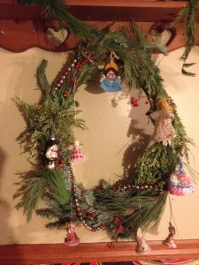 One of the wreaths we made last night, this one with little figures from Rebecca's grandmother's collectipm/