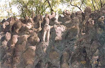A heap of boulders processed by nature to human likeness. Attending the sermon.