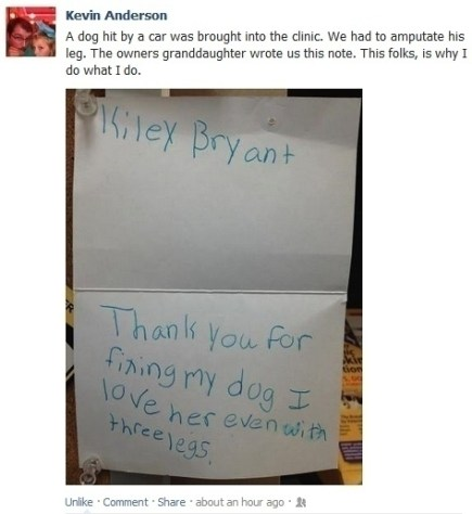 Little girl sharing a note for the vet thanking them for helping her dog.