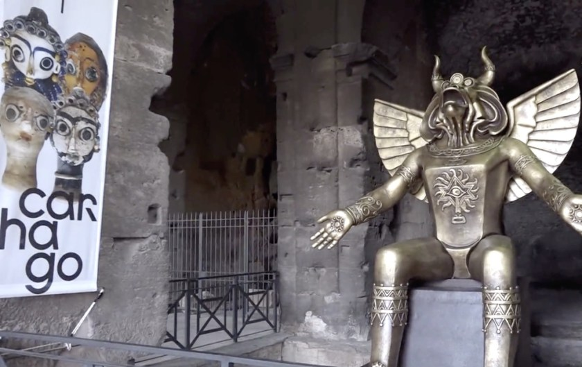 Statue at colosseum, which people allege was placed by the Vatican.