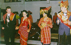 After the dowry is paid, the bride and groom are dance the landek for their guests in the middle of the reception hall