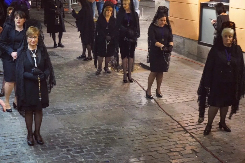 women in black during holy week in spain