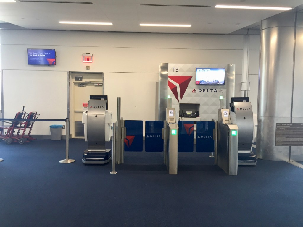 Two e-gates and Mobile Podium - Delta Air Lines Smart Boarding Experience Harsfield-Jackson Atlanta Two e-gates and Mobile Podium - Delta Air Lines Smart Boarding Experience Harsfield-Jackson Atlanta International Airport Gate T2  Airport Gate T2