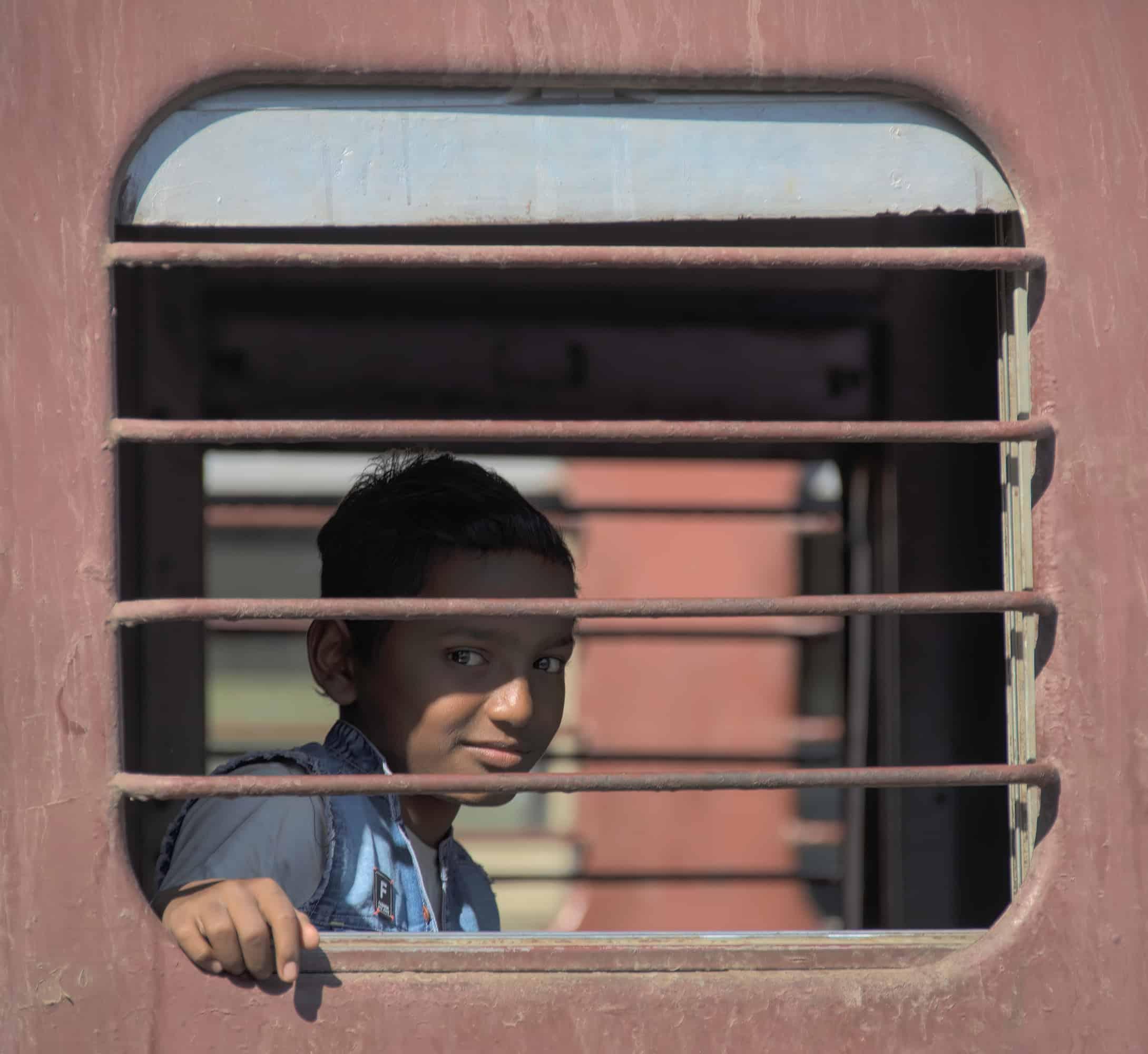 Boy on a train in India