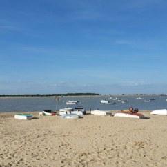Barcas en la desembocadura del Río Guadalquivir en Sanlucardebarrameda en Cádiz