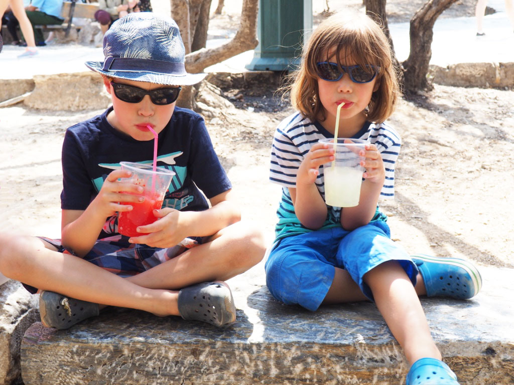 Kids drinking slush puppies