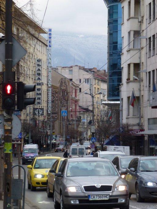 The mountain overlooks the city.