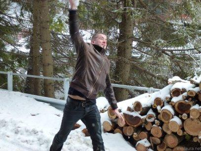 Mid-snowball toss.