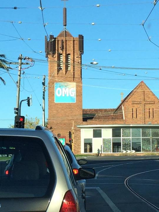 First photo: a church with a big 'OMG' sign on it.